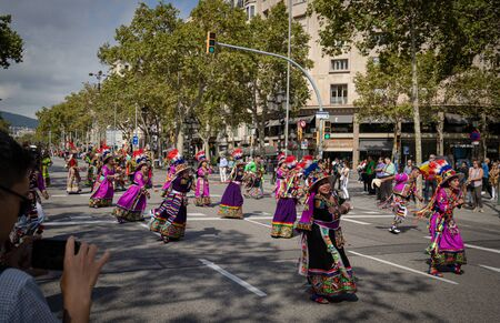 Barcelona, Spain. 12 Ocober 2019: Bolivian Tinku San Simon dancers during Dia de la Hispanidad in Barcelona.