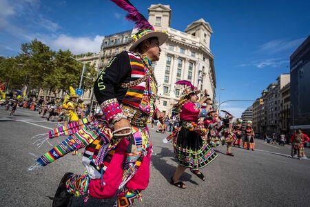 Barcelona, Spain. 12 Ocober 2019: Bolivian Tinkus San Simon dancers during Dia de la Hispanidad in Barcelona.