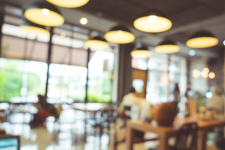 Blur background of coffee shop in vintage tone