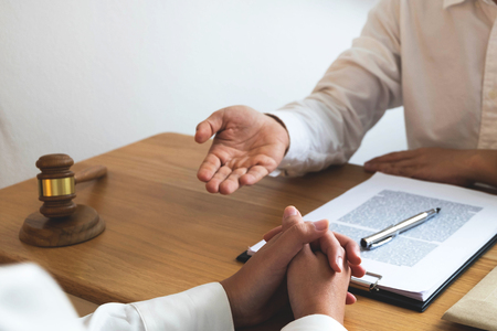 Photo pour Lawyer present client with contract papers on the table in office. consultant lawyer, attorney, court judge, concept. - image libre de droit