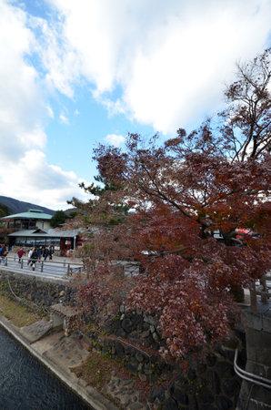KYOTO, JAPAN - DEC 09: Tourists visit Arashiyama in Kyoto, Japan on December 09, 2014. Arashiyama is a nationally-designat ed Place of Scenic Beauty and Historic Site.
