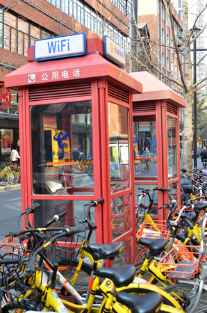 SHANGHAI, CHINA- JAN 08, 2018: Phone booths locate in Shanghai, China. As cell phone getting more popular phone booth is rarely seen today.