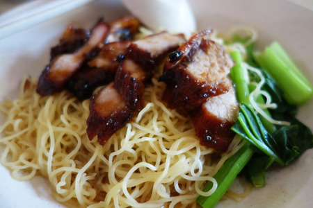 Popular Singapore Chinese street food, wantan mee, kind of noodles serve with bbq pork