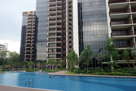 SINGAPORE - JUN 26, 2018: Typical Singapore high rise housing estate with big swimming pool.