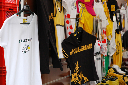 PARIS, FRANCE - JUL 23 2018: Street stand full of various souvenirs of Le Tour de France during the last stage of the competition in Paris, France.