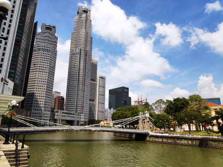 Photo for SINGAPORE - SEP 23, 2018: View of Cavenagh Bridge with Singapore business district on background. Cavenagh Bridge the only suspension bridge and the oldest bridge in Singapore - Royalty Free Image
