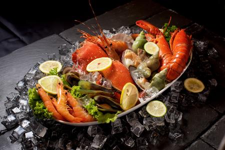 Foto de Seafood lobster plater with ice on slate - Imagen libre de derechos