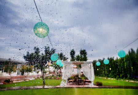 Photo for Outdoor ceremony. Decoration of celebrations. Rain through the window. Wedding planner - Royalty Free Image