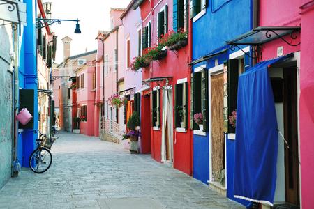 Colorful buildings in Burano island street in Venetian lagoon, Italy