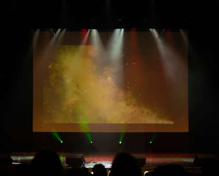Photo pour An empty stage of the theater, lit by spotlights and smoke before the performance - image libre de droit