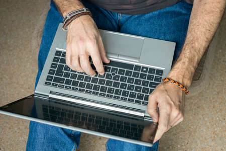 Photo for Man working with laptop from home - Royalty Free Image