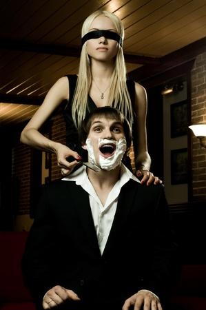 beautiful youth woman  with blindfold,  get shave guy  hazardous razor