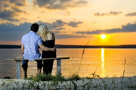Photo for romantic evening date on nature, couple on beautiful sunset on  lake - Royalty Free Image