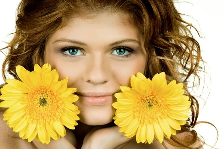 the very  pretty red-haired freckled young woman with yelow flowers , horizontal closeup portrait, isolated
