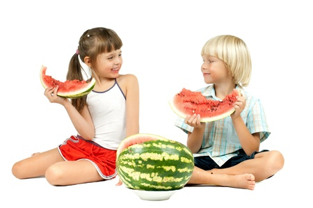 two children  eating watermelon and smile, on white background, isolated