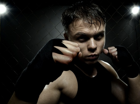 horizontal photo  muscular young  guy street-fighter,  aggression look, hard light