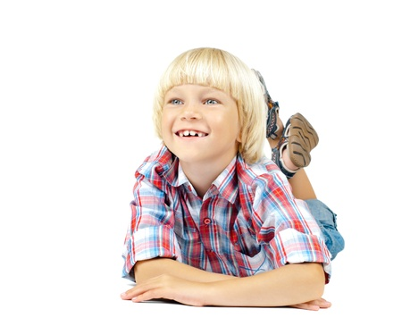 the little children boy slyly smile,  lying on white background, isolated