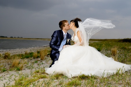 cutie happy married  couple  on nature, puff wind, hot kiss
