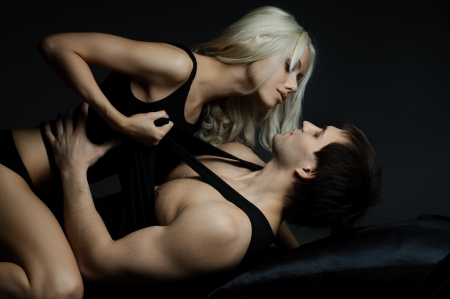 Photo for muscular handsome sexy guy with pretty woman, on dark background, glamour  light - Royalty Free Image