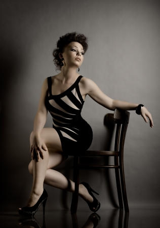 the very  pretty woman portrait , sit on chair, sensual look