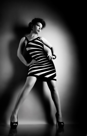 the very  pretty woman portrait , model  stand on podium, sensual look, black-and-white