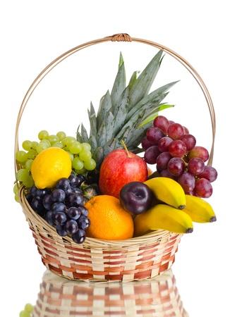 still life of  multi-coloured fruits in big  basket, on white background, isolated