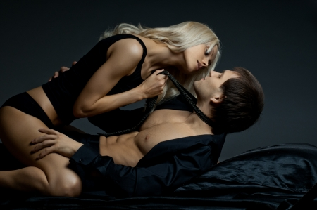 Photo pour muscular handsome sexy guy with pretty woman, on dark background, glamour  light - image libre de droit