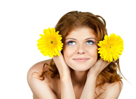 the very  pretty red-haired blue eyed young woman  with yellow flower,  smile , horizontal close up portrait