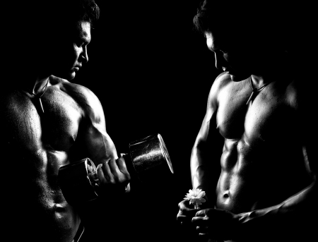 very power athletic guy ,  execute exercise with  dumbbells, on bkack background, black-and-white