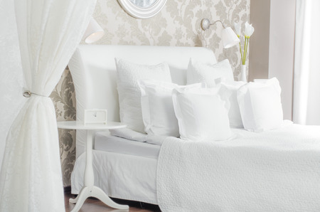 big the white double bed  in light  bedroom,  in hotel or home