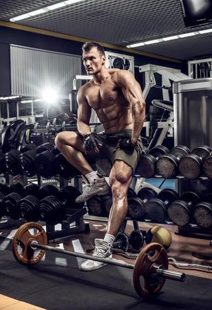 very power guy - bodybuilder rest in gym, vertical photo