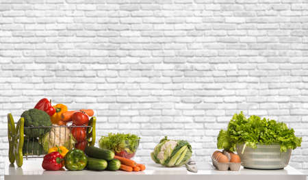 Photo pour allsorts of vegetable group on table, on white brick wall background - image libre de droit