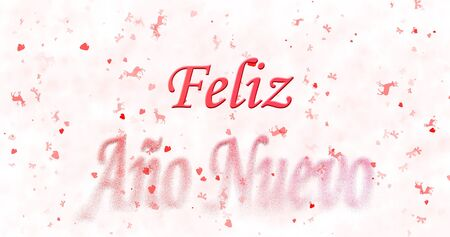 Happy New Year text in Spanish Feliz ano nuevo turns to dust from bottom on white background