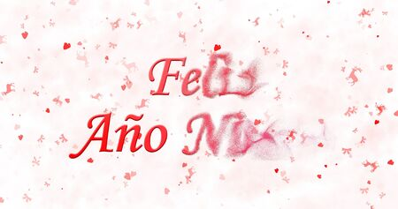 Happy New Year text in Spanish Feliz ano nuevo turns to dust from right on white background