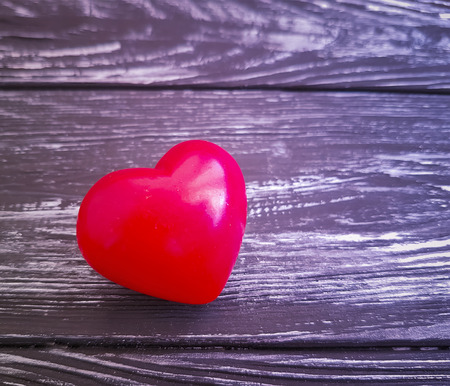 red heart on wooden