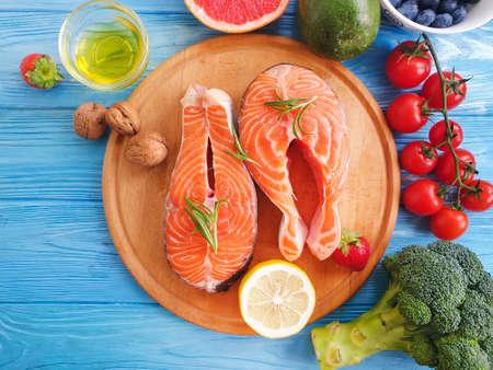 Photo for fresh salmon tomato, on wooden background - Royalty Free Image