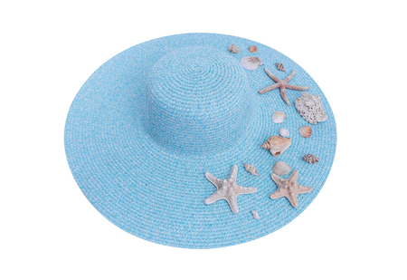 Starfish and seashells on a hat. Isolated on white background.