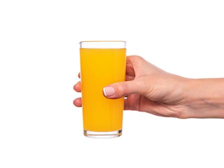 Photo pour Female hand holding a glass with orange or citrus juice on white background. - image libre de droit