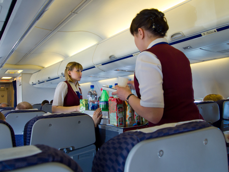 Flight attendants are fed passengers during flight