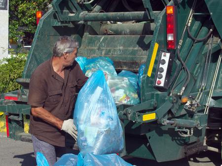 Foto de Lazarevskoe, Sochi, Russia - June 27, 2014:  Garbage collection in the city streets Lazarevskoye - Imagen libre de derechos