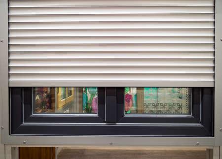 Photo pour Roller shutters installed on a plastic window - image libre de droit