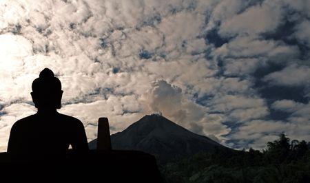 Indonesia, Java: Merapi  eruption, may 2006, and buddha in meditation