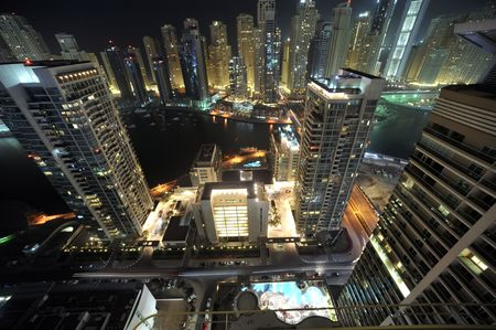 United Arab Emirates: Dubai skyline at night, an impressive view of the new city in the area of dubai marina. the second largest manmade marina in the world. a residental district
