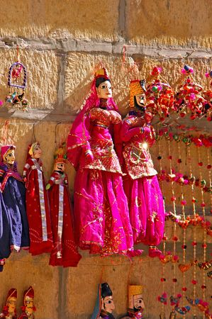 India, Rajasthan, Jaisalmer: marionette; traditional wooden figures representing women in a traditional red sari