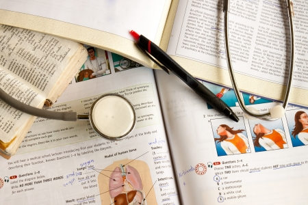 The text books and a stethoscope