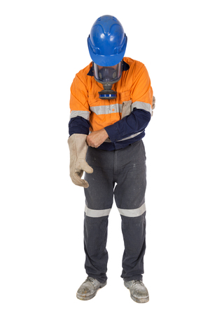 An industrial worker donning his personal protective equipment.