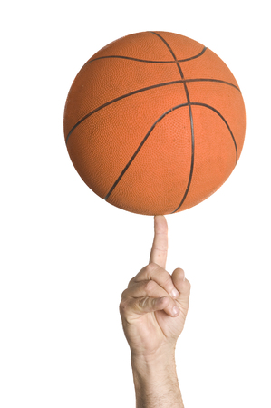 Photo pour close up of a basketball spinning on a finger. - image libre de droit