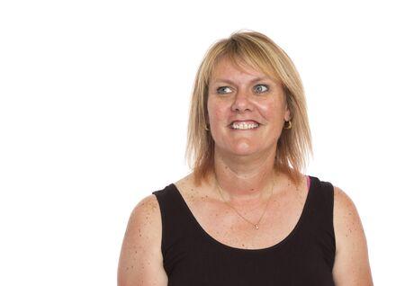 Foto de A portrait of a normal attractive woman in her forties. - Imagen libre de derechos