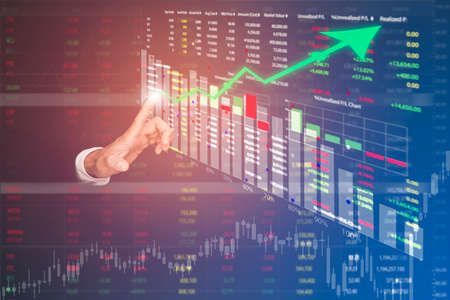 Foto de Businessman touch line arrow on the graph chart of stock market ,Technology Process System Business with Investment and stock market concept gain and profits with faded number charts. - Imagen libre de derechos