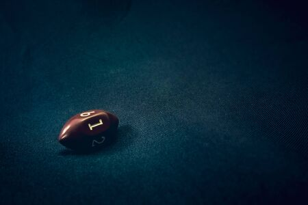 Photo for 6 sided football shaped die for a game - Royalty Free Image